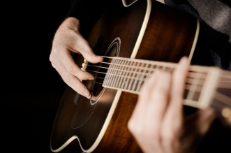 playing-acoustic-guitar
