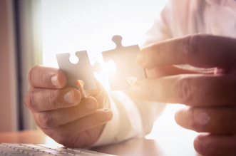 45215259 - business solutions, success and strategy concept. businessman hand connecting jigsaw puzzle.
